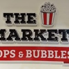 Logo The Market Pops & Bubbles en AM 910 Radio La Red