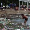 Logo Quilmes: un grupo de estudiantes invita a vecinos a hacer una limpieza de la costa