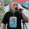 Logo Mario Farias dialogando con Tito Guzman  en La Feria