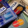 Logo NSN: Economia - Tarjetas de Credito posición dominante.